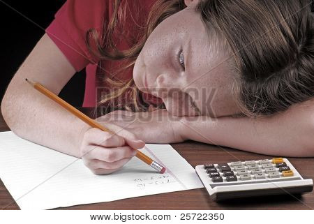young girl erasing mistake on math homework