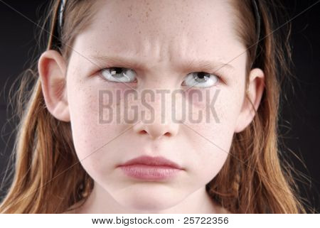 young girl looking angry or upset