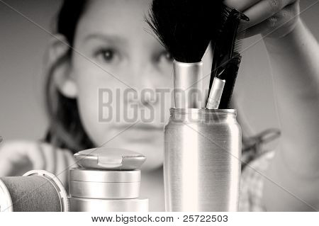Young girl getting into mommy's makeup supplies