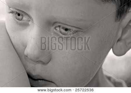 young boy upset after getting booboo on elbow