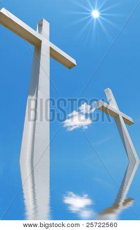 Beautiful cross statues under sunny blue sky