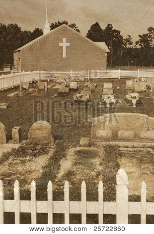 Antique cemetery by church with aged metallic overlay