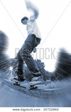 Young skateboarder on grinding rail with sun setting