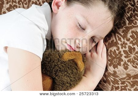 Young child napping on couch
