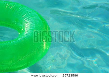 Pretty green pool toy on sparkling water