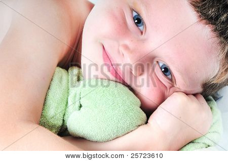 Young toddler boy hugging lovey toy