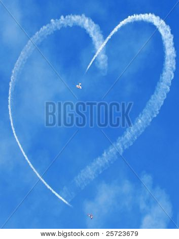 small planes making heart in sky