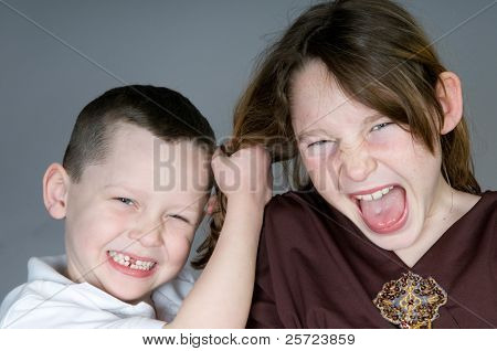 Young boy and girl in a fight