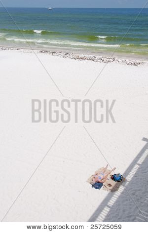 PENSACOLA BEACH - JUNE 23:  An unidentifed beachgoer lies on the sand on June 23, 2010 in Pensacola Beach, FL