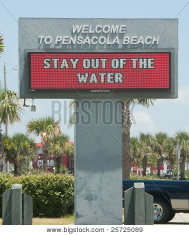 PENSACOLA BEACH - JUNE 23:  An electronic warning sign alerts beachgoers that the waters are closed on June 23, 2010 in Pensacola, FL.