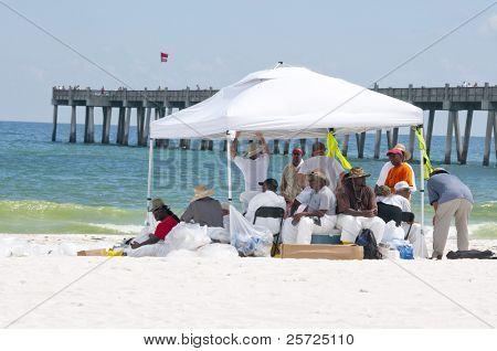 PENSACOLA BEACH - JUNE 23: BP workers attempt to clean oil off the beaches on June 23, 2010 in Pensacola Beach, FL