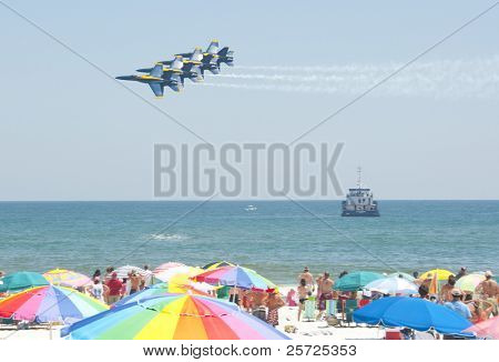 PENSACOLA BEACH - 8 JULY: The U.S. Navy Blue Angels flight demonstration team perform over Pensacola Beach, Florida on July 8, 2010 as part of the annual