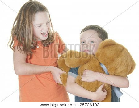 young boy and girl fighting over bear