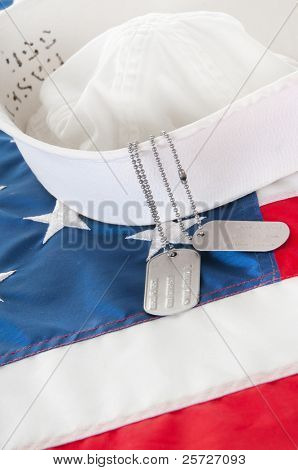 hat and dog tags from sailor