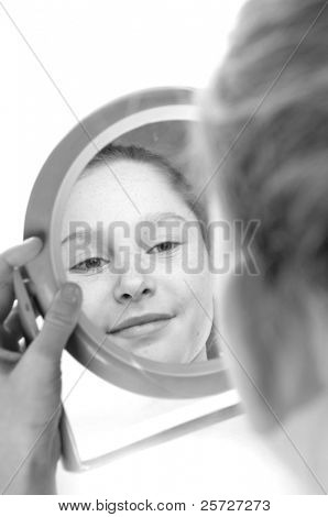 girl looking at reflection in mirror