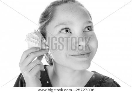 girl listening to seashell sounds