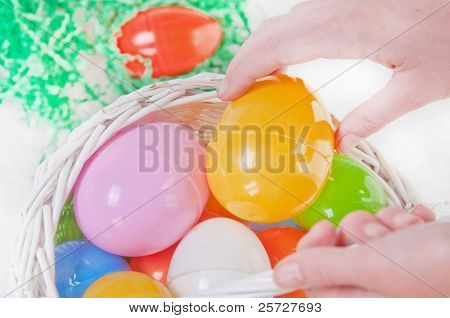 child finding eggs during easter hunt