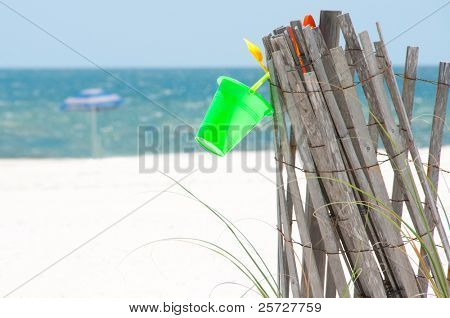Empty beach with sand dune fence