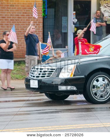 PENSACOLA - AUGUST 24: The fallen body of 19 year old US Marine Lance Cpl Travis Nelson returns home to Pensacola, FL on August 24, 2011. Nelson was killed  one month after arriving in Afghanistan.