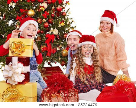 Children with gift box near Christmas tree. Isolated.