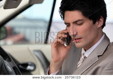businessman in his car making a call