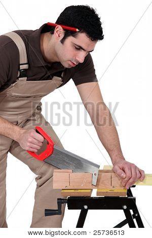Man cutting a piece of wood