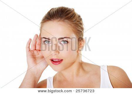 Teen blond woman trying to listening a gossip