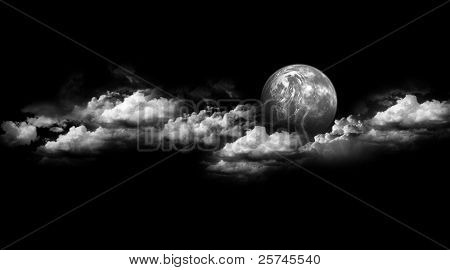 Moon between the clouds black & white
