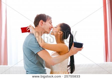 Romantic Couple Kissing After Exchanging Gifts