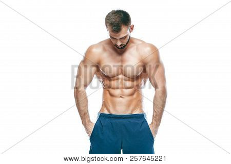 poster of Bodybuilder Posing. Beautiful Sporty Guy Male Power. Fitness Muscled In Blue Shorts. On Isolated Whi