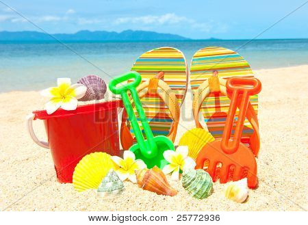 Spade And Other Toys On Tropical Beach
