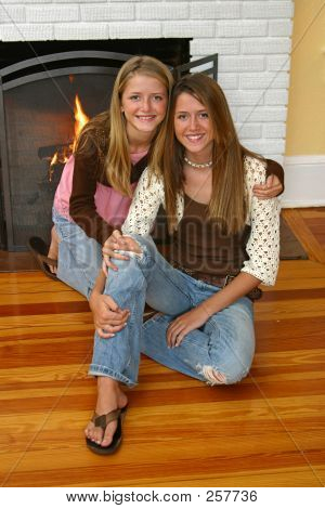 Beautiful Sisters By Fireplace