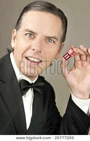Confient Gentleman In Tux Holding Dice, Side