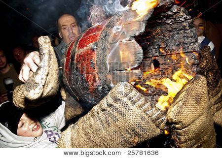 Gloves Are Burning As A Young Roller Is Helped During A Burning Barrel Exchange At The 2011 Tar Barr