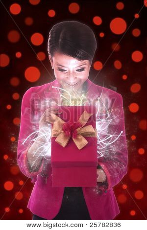Beautiful Woman Opens A Gift