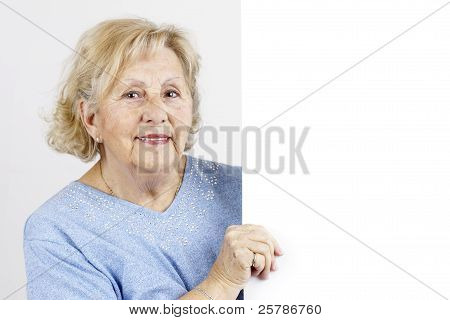 Senior Woman Holding Blank Sign