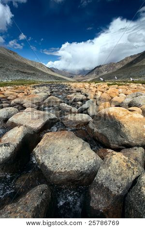 Valley with river and stones in Himalayas.