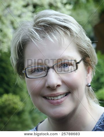 Blond woman with fashion eyeglasses