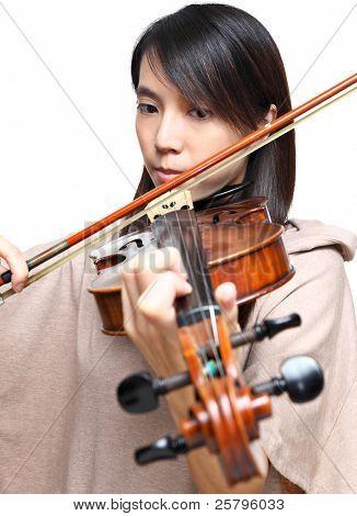 Young woman play violin