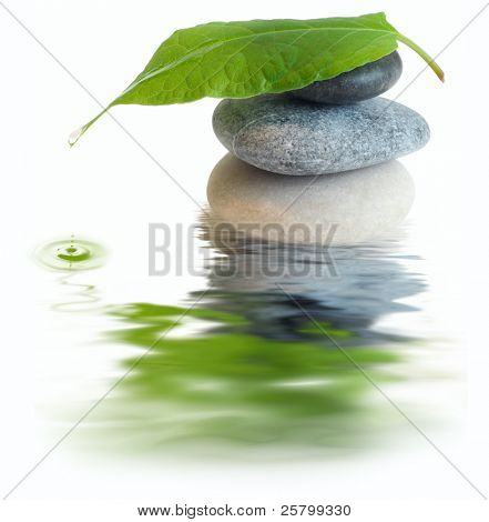 Stones with leaf and water drop