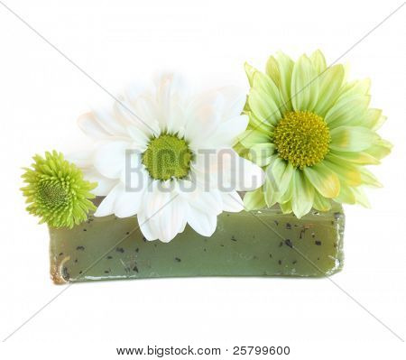 Handmade natural herbal soap with green daisy flowers.