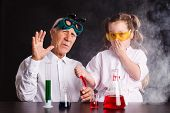 Chemical Experiments In The Laboratory. Girl Doing A Chemical Experiment poster