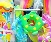 foto of floaties  - Colorful collection of inflatable beach toys - JPG