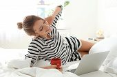 Beautiful Young Woman Using Laptop In Bed At Home. Lazy Morning poster
