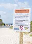 PERDIDO KEY - JUNE 9: A health hazard sign is shown posted on a popular vacation resort beach on Jun