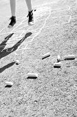 stock photo of hopscotch  - kid playing hopscotch on playground - JPG