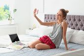 Beautiful Young Woman Taking Selfie In Bed At Home. Lazy Morning poster