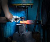 Men Make A Metal Red-hot Detail In An Old Smithy, Close-up, Red-hot Meta poster
