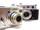 Постер, плакат: Новые и старые камеры над белой