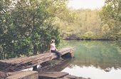 Sitting On A Rustic Large Hewn Timber Jetty Very Worn And Weathered In Remote Bushland Creek Austral poster
